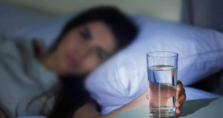 Is it good to drink water before bed