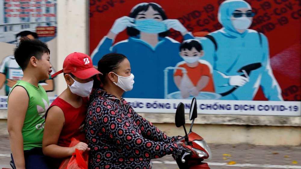 Vietnamese woman ride motobike at Covid time in Vietnam