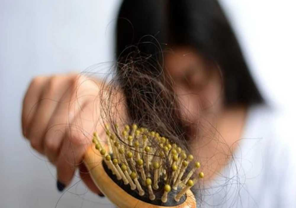 What is hair loss due to disease